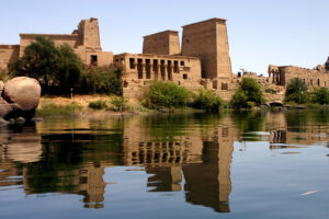 Photo of a Philae temple next to a body of water